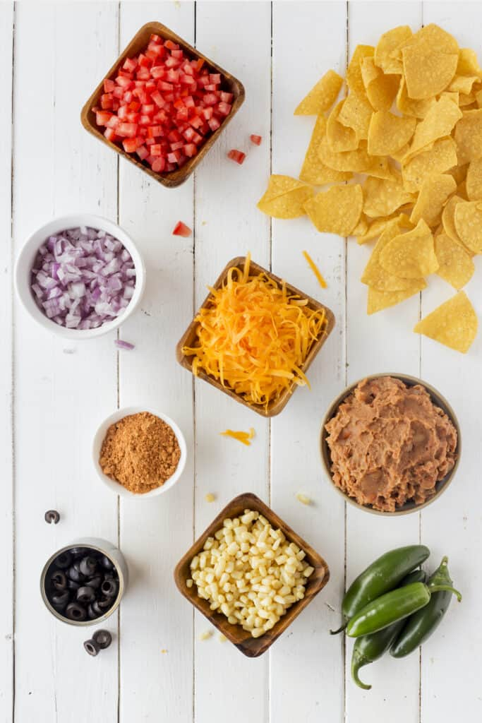 Overhead shot of nachos and toppings
