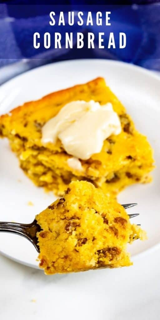 Slice of sausage cornbread with a pat of butter on top on white plate with one bite on fork and recipe title on top of image