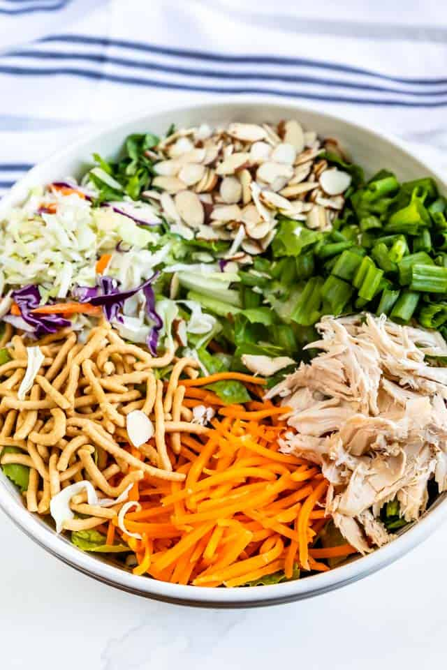 Chinese chicken salad ingredients all separated in bowl before being tossed together