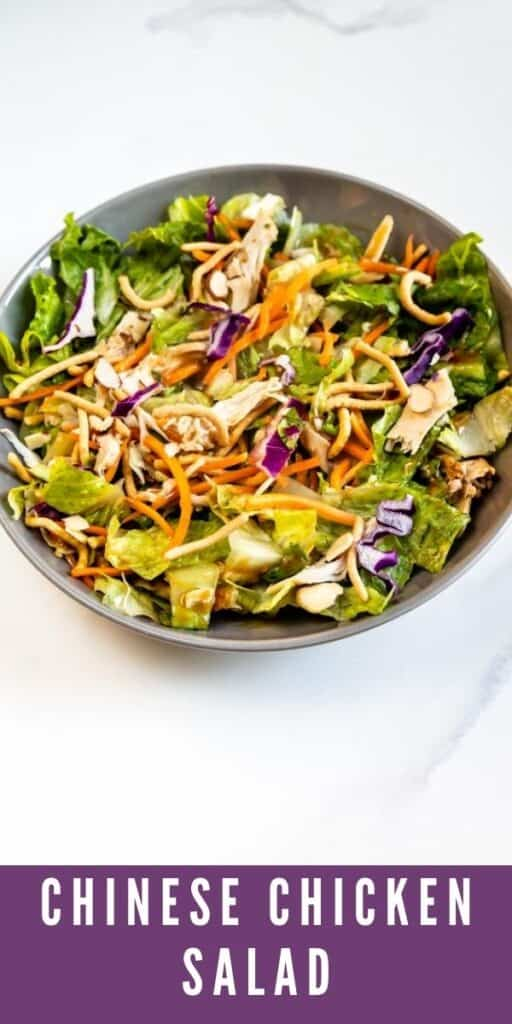 Overhead shot of bowl full of chinese chicken salad with recipe title on bottom of image