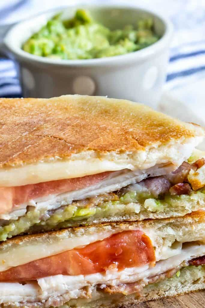 Close up shot showing panini cut in half and all ingredients in finished sandwich