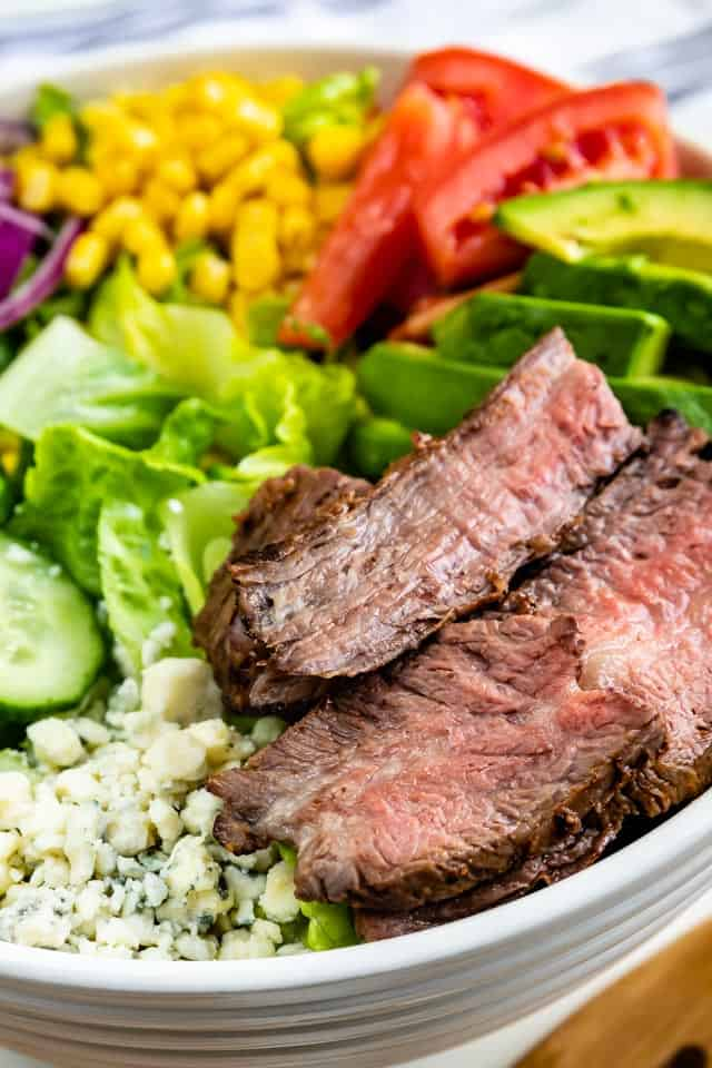 Close up shot of steak salad ingredients all in one bowl