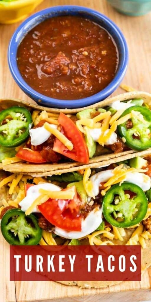 Overhead view of turkey tacos with salsa on the side with recipe title on bottom of photo