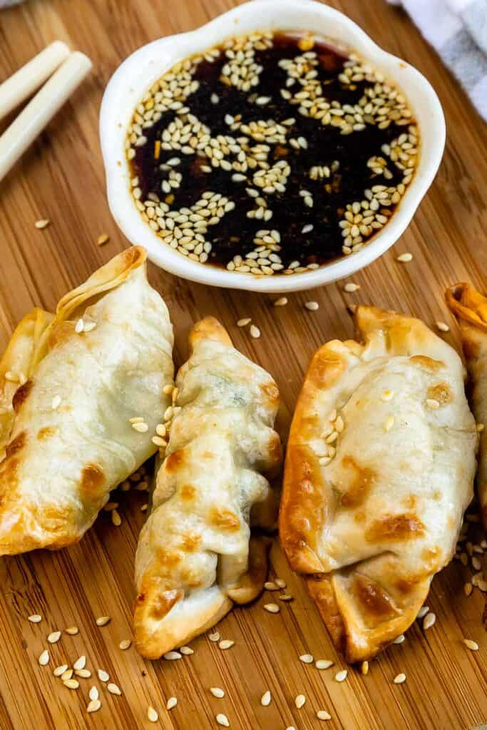 Close up shot of air fryer potstickers with dipping sauce