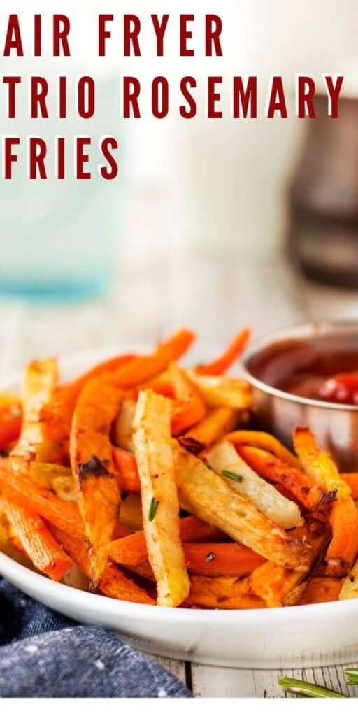 Close up of air fryer trio rosemary fries with ketchup and recipe title on top of photo