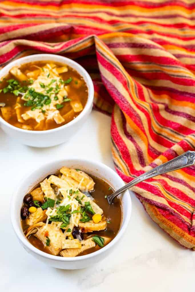 Overhead shot of easy chicken tortilla soup in two bowls
