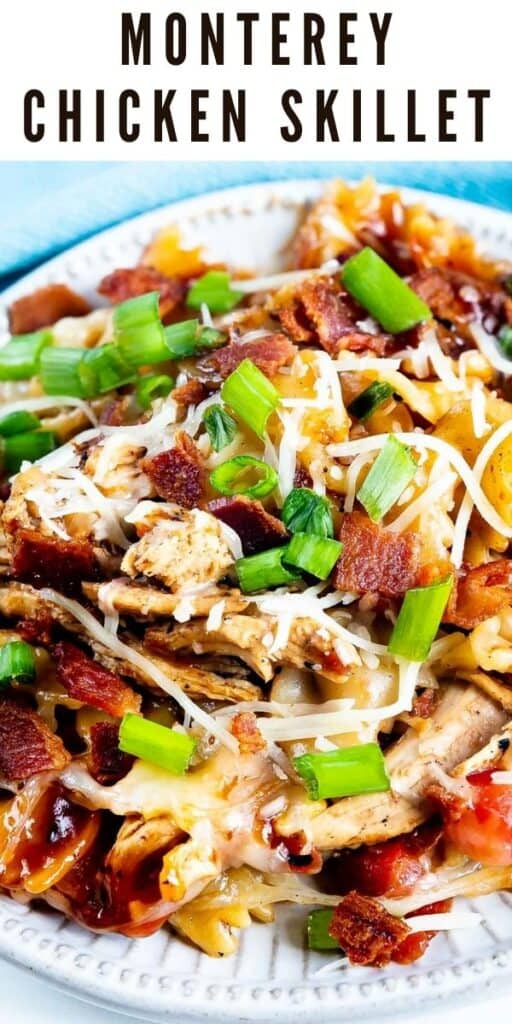 Close up shot of Monterey chicken skillet served on a white plate and garnished with green onions and recipe title on top of image
