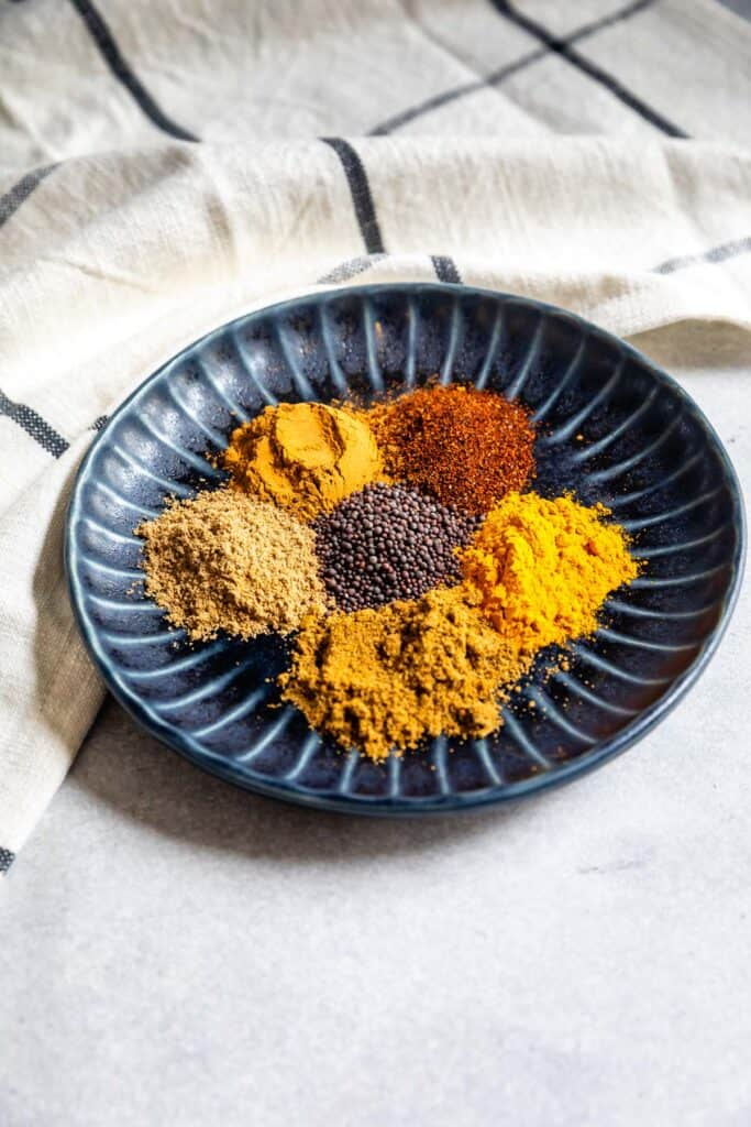 All spices separated on a plate that make curry powder