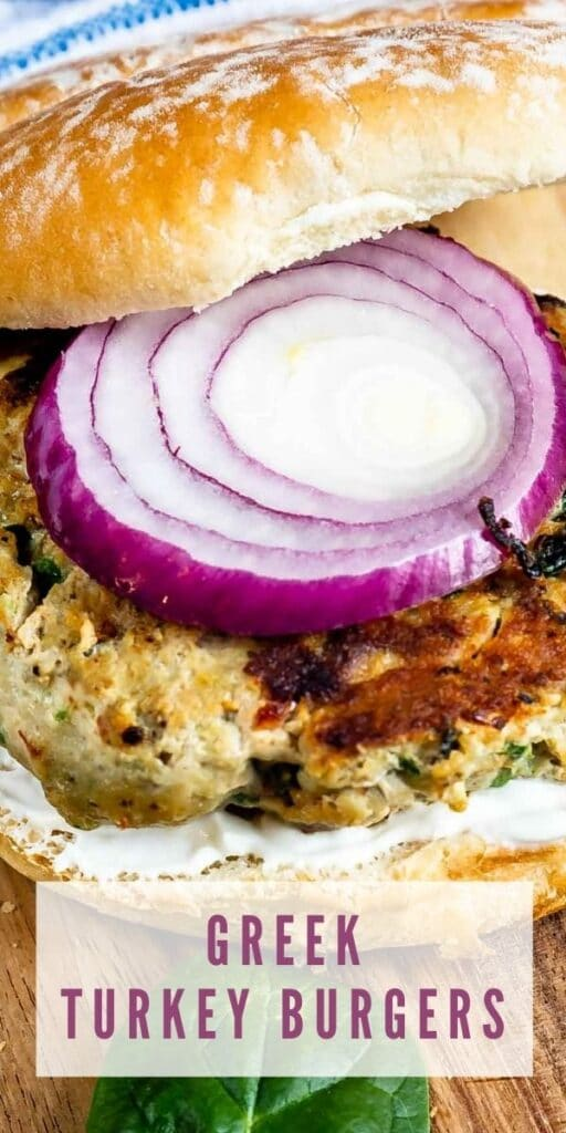 Close up shot of a greek turkey burger with onion on top
