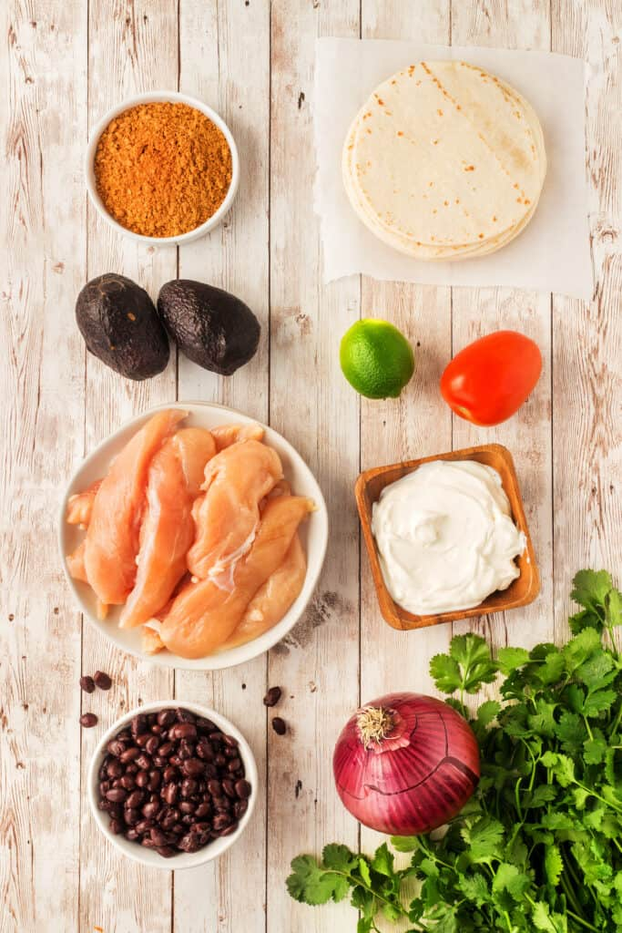 Overhead view of all ingredients needed to make chicken street tacos