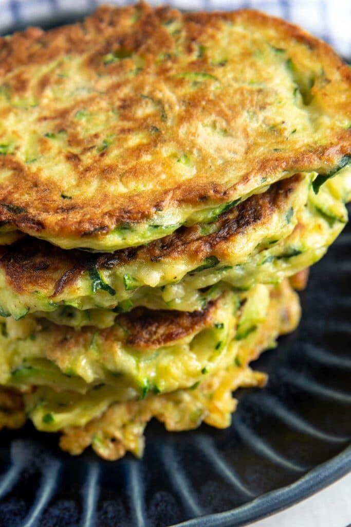 Close up shot of stacked zucchini fritters
