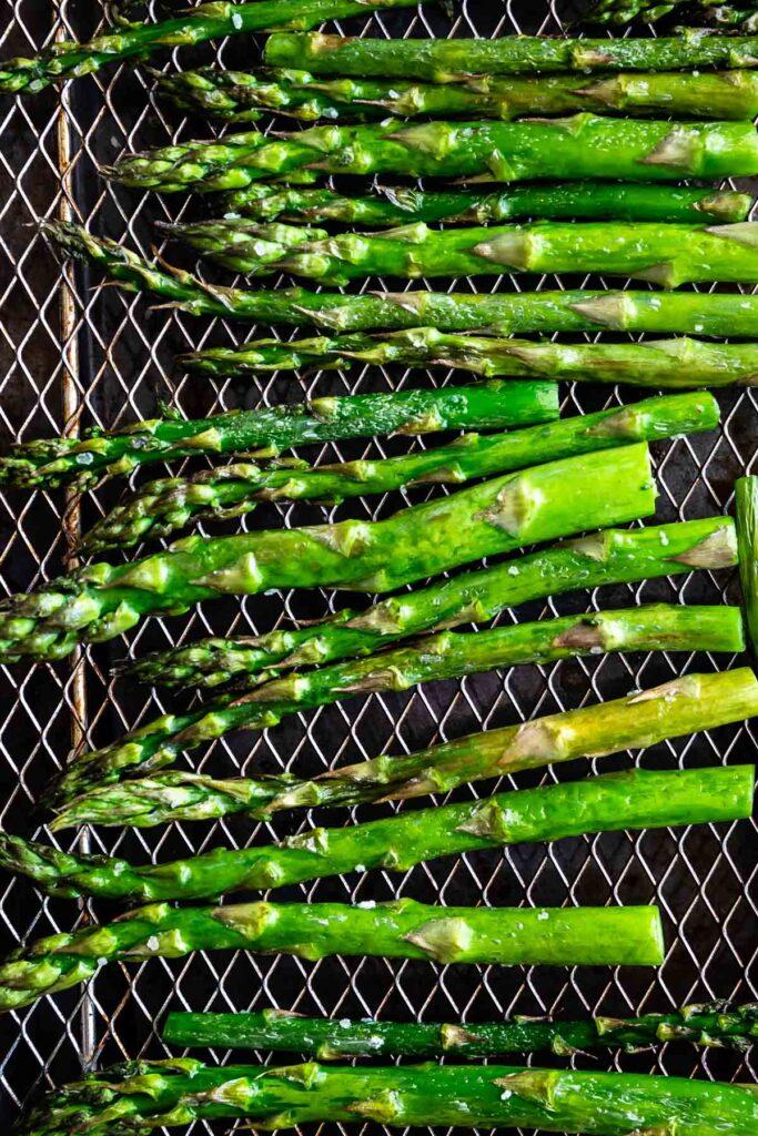 Overhead shot of asparagus on the air fryer rack