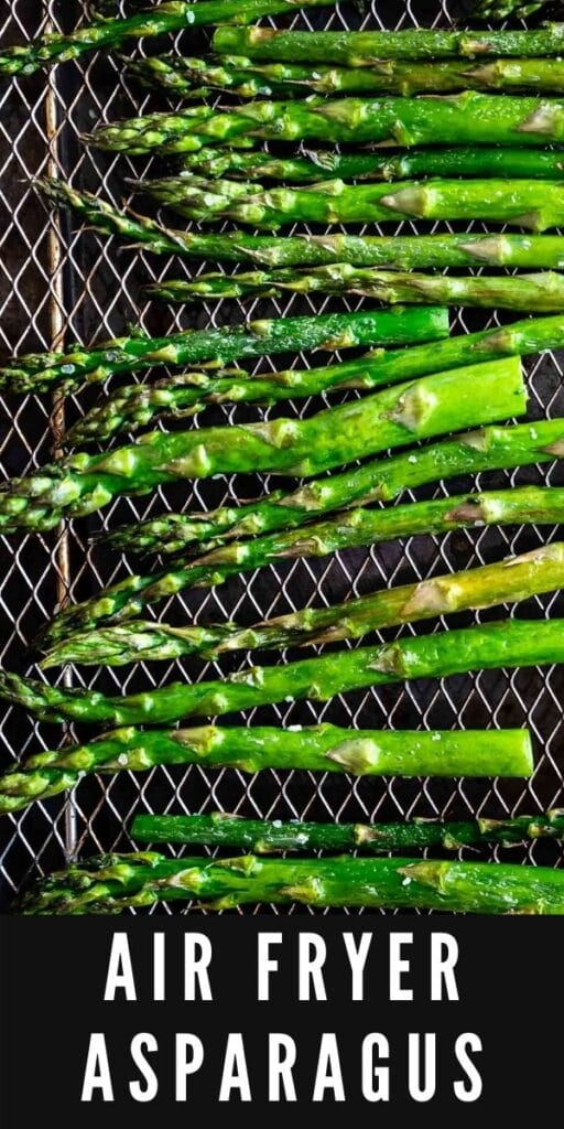 Overhead shot of asparagus on the air fryer rack with recipe title on bottom of photo