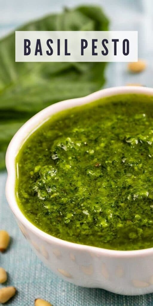 Close up overhead shot of basil pesto with recipe title on top of image