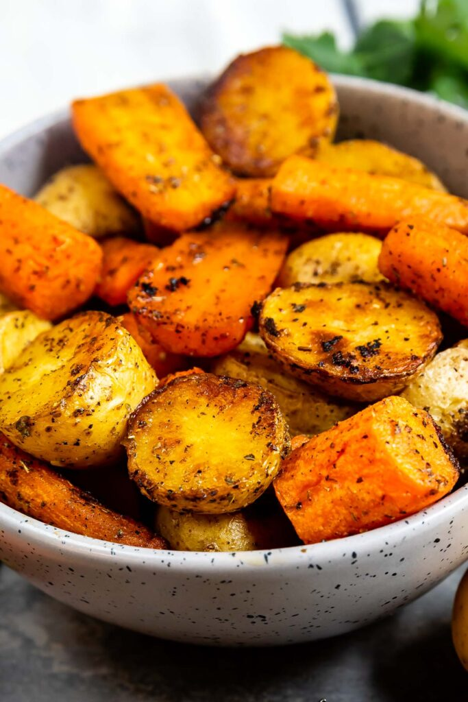 Close up shot of roasted potatoes and carrots