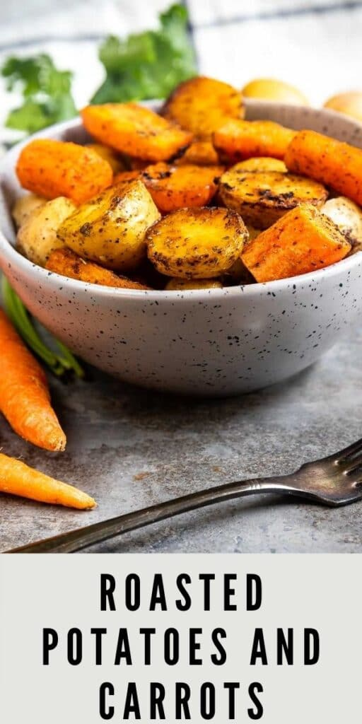 Bowl full of roasted potatoes and carrots with a fork in front of it and recipe title on the bottom of photo