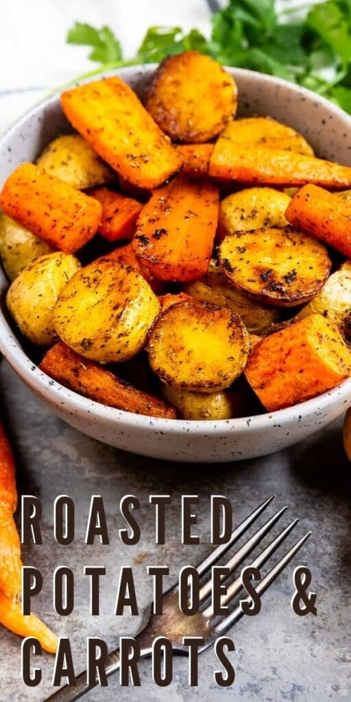 Overhead shot of roasted potatoes and carrots with recipe title on bottom of photo