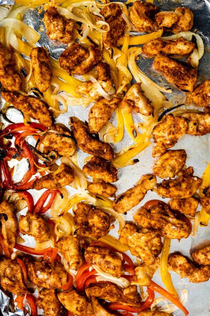Overhead view of sheet pan chicken fajitas on a sheet pan