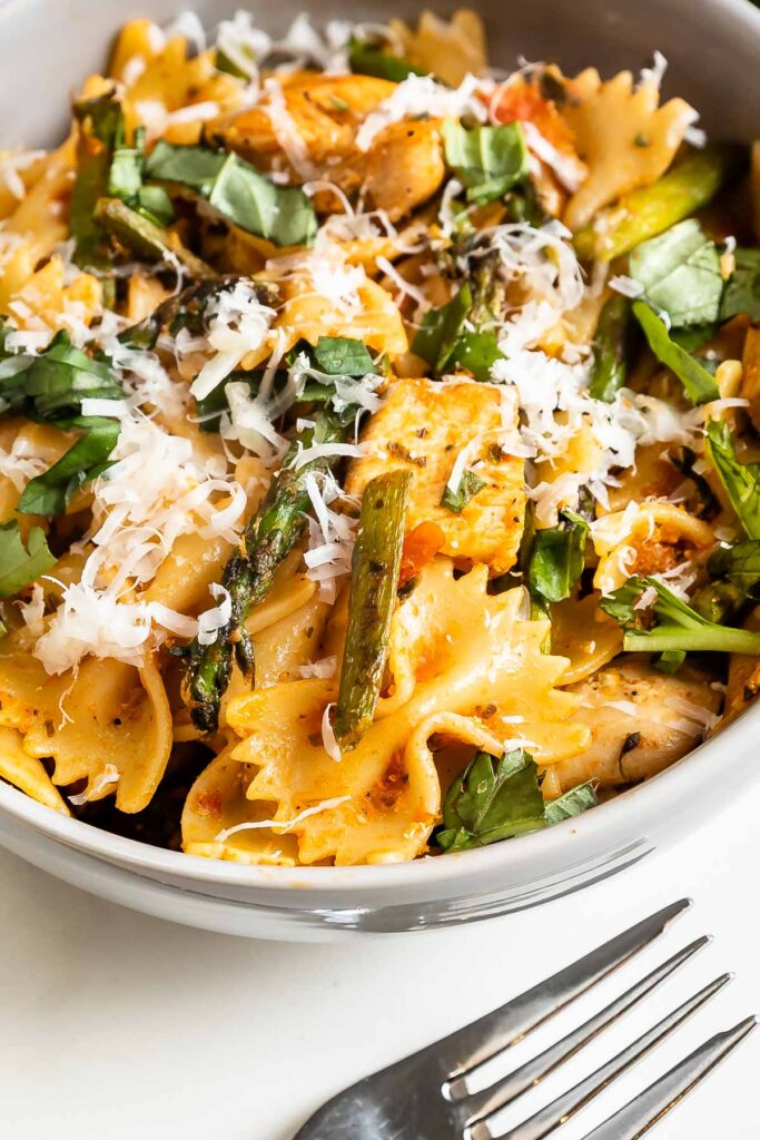 Close up overhead shot of sun-dried tomato pesto pasta in a bowl