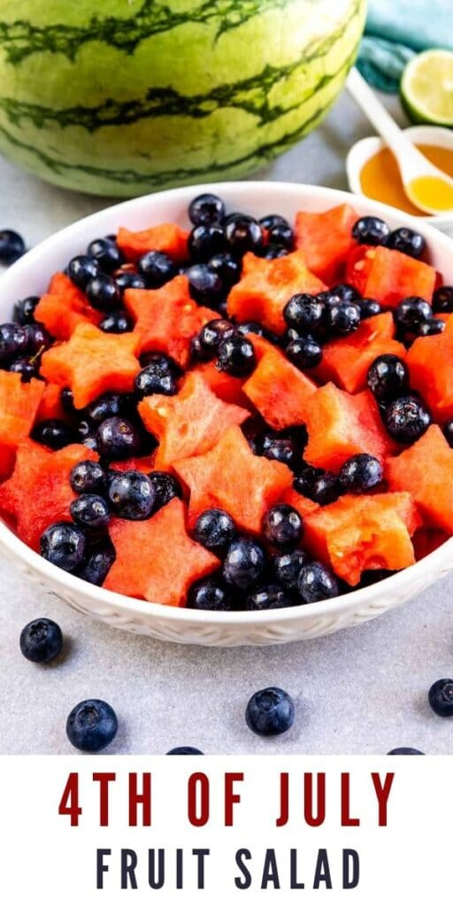 Big bowl of fruit salad with watermelon and dressing in background and recipe title on bottom of photo