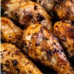 Close up shot of easy barbecue chicken with dipping sauce and recipe title on bottom of image