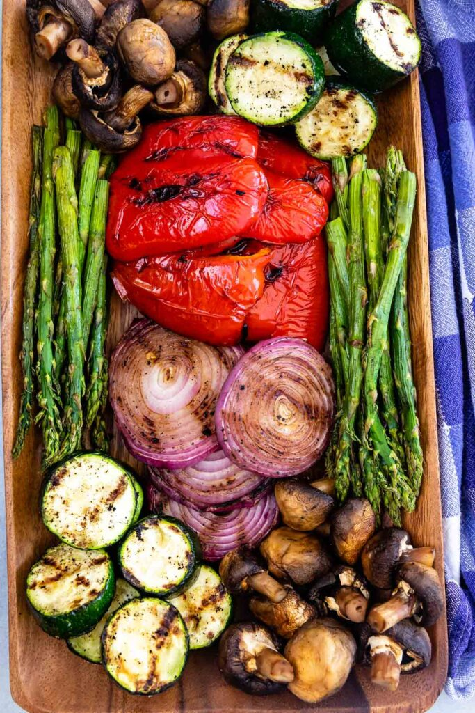 Overhead shot of grilled vegetables on a wodden cutting board
