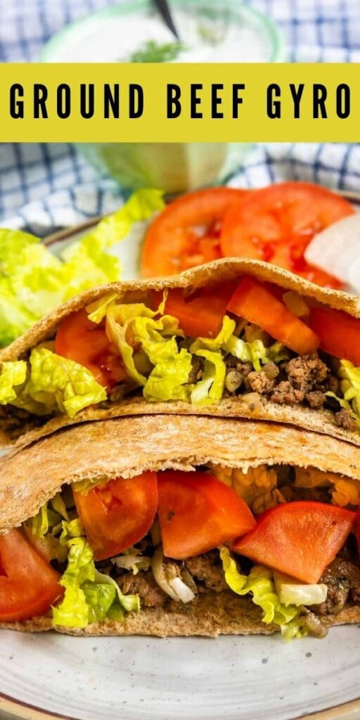 Close up shot of two ground beef gyros loaded with traditional gyro toppings and recipe title on top of image