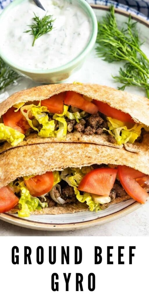 Two ground beef gyros loaded with traditional gyro toppings and recipe title on bottom of photo