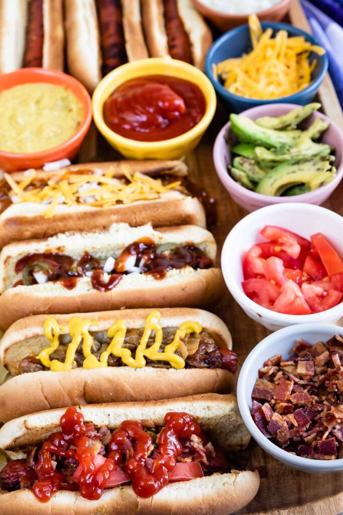 Close up shot of hot dog bar with hot dogs and all the toppings
