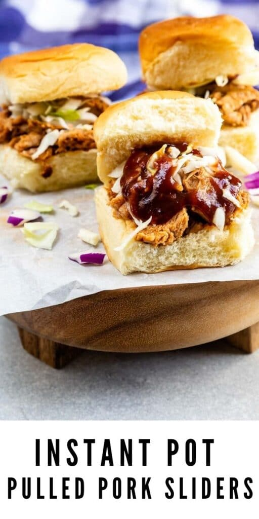 Three instant pot pulled pork sliders on parchment paper and recipe title on bottom of image