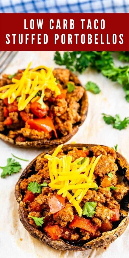 Two taco stuffed portobello mushrooms topped with shredded cheese and recipe title on top of image