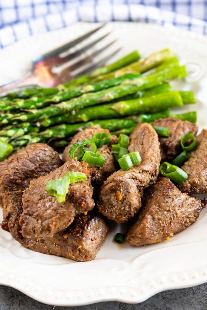 Plate full of air fryer steak tips with asparagus