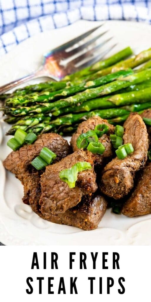 Plate full of air fryer steak tips with asparagus with recipe title on bottom of image