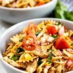 Two bowls full of BBQ chicken pasta salad