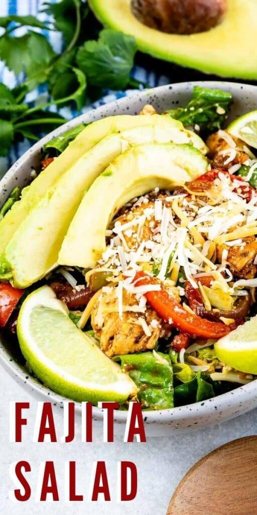 Overhead shot of fajita salad in a salad bowl with recipe title on bottom of photo