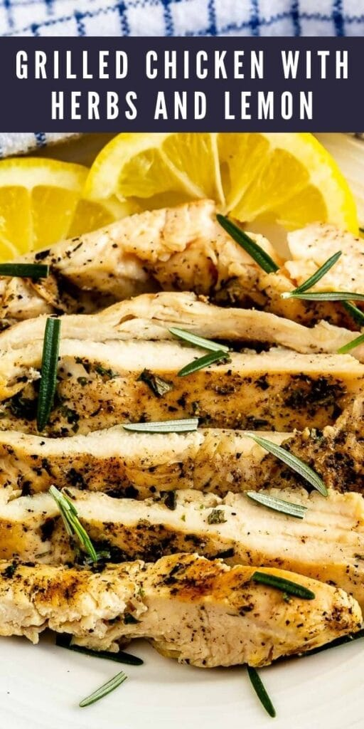 Close up shot of grilled chicken with herbs and lemon with recipe title on top of image