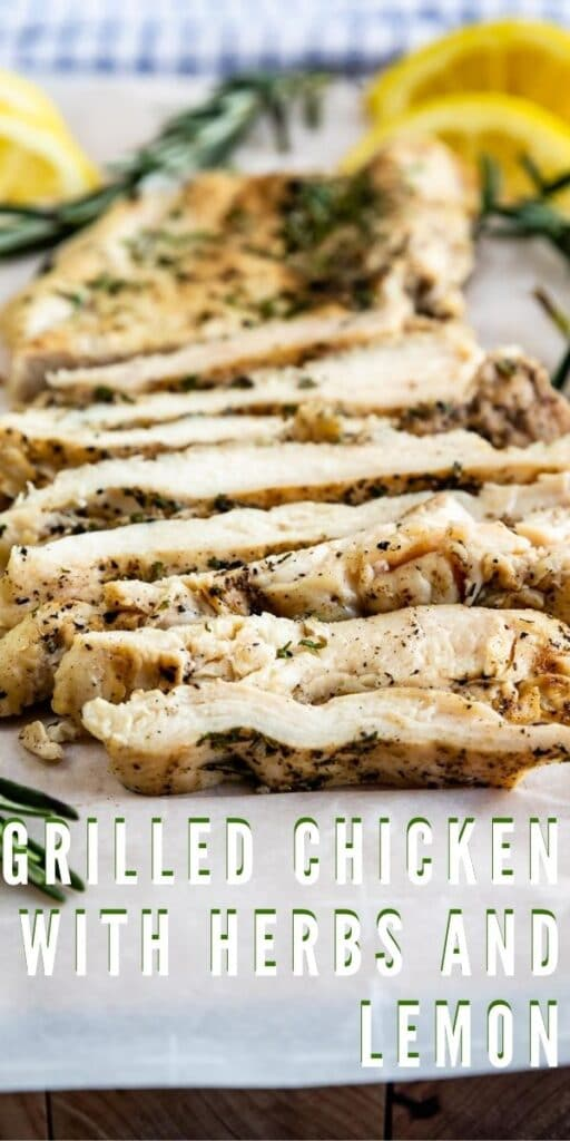 Close up shot of sliced grilled chicken with herbs and lemon with recipe title on bottom of photo