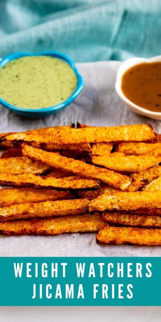 Jicama Fries on parchment paper with dipping sauces behind them and recipe title on bottom of photo