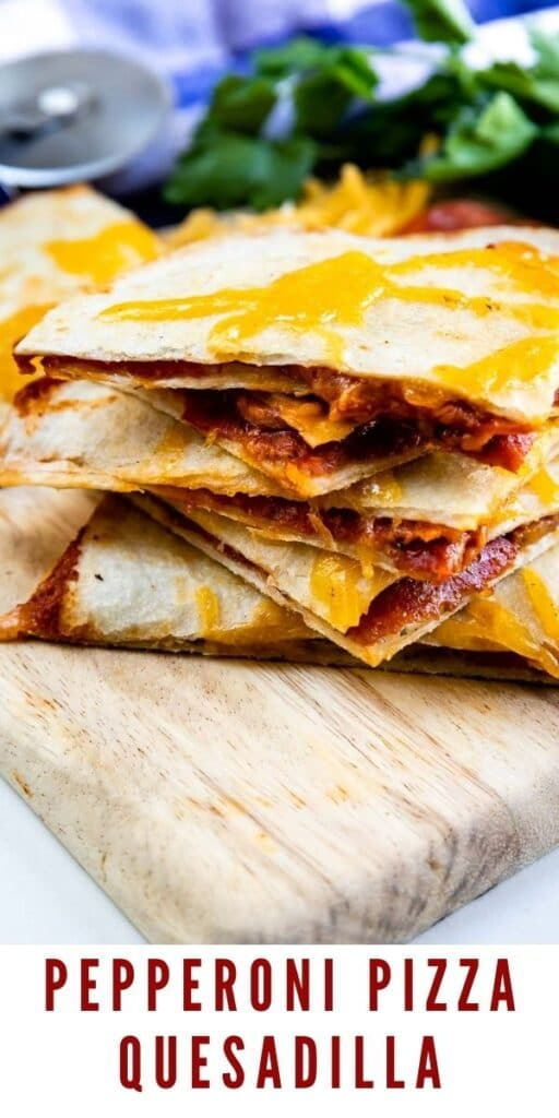 Stack of four pieces of pepperoni pizza quesadillas on a cutting board with recipe title on bottom of image
