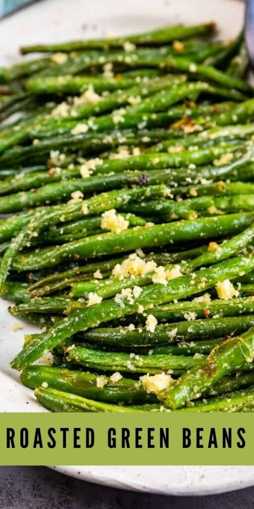 Roasted green beans on a serving plate with recipe title on bottom of photo
