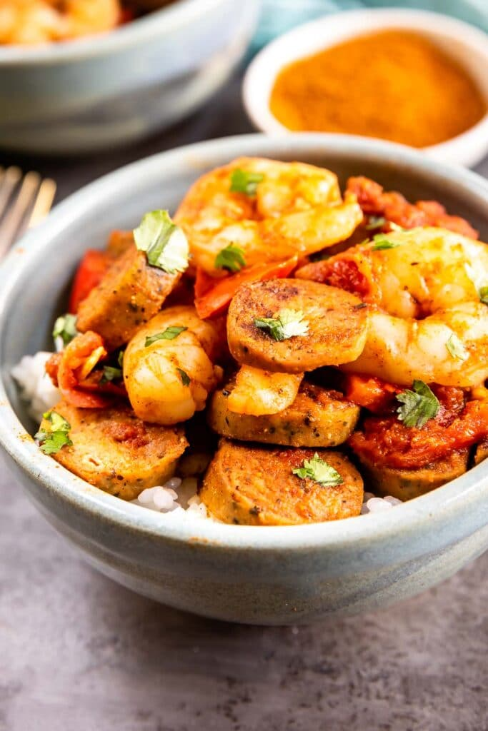 Bowl of spicy shrimp and sausage skillet over white rice