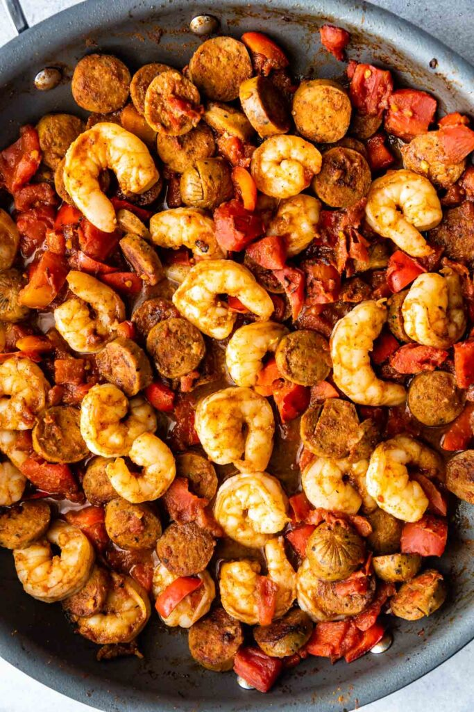 Overhead shot of spicy shrimp and sausage in skillet