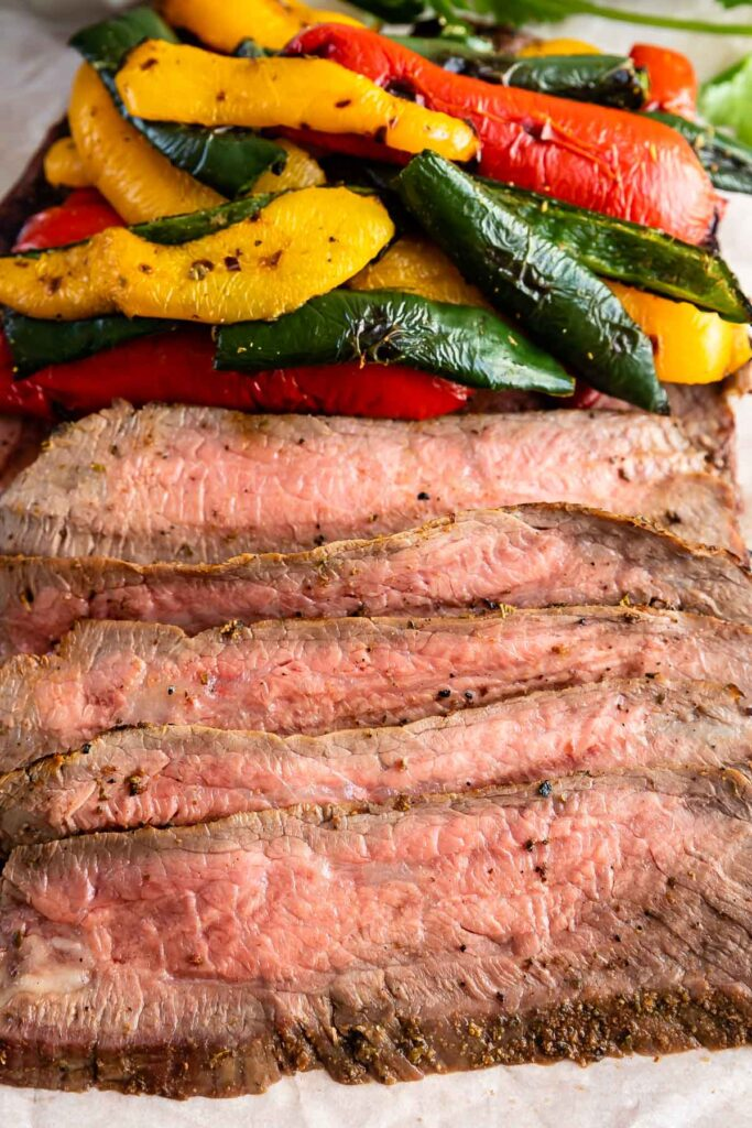 Close up shot of grilled steak and peppers