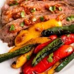 Plated steak and peppers with recipe title on the bottom of photo