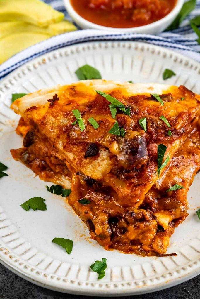 Close up shot of tortilla casserole slice on a plate