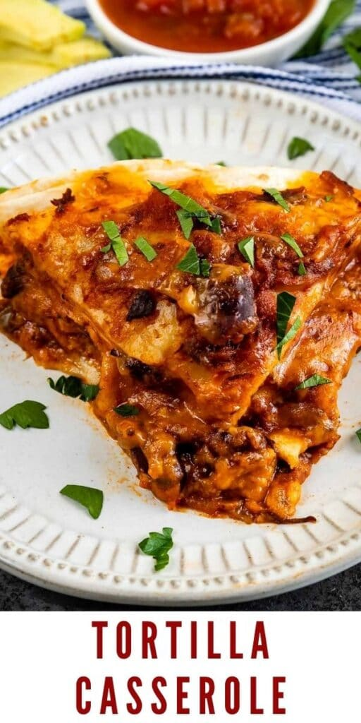 Close up shot of tortilla casserole slice on a plate with recipe title on bottom of image