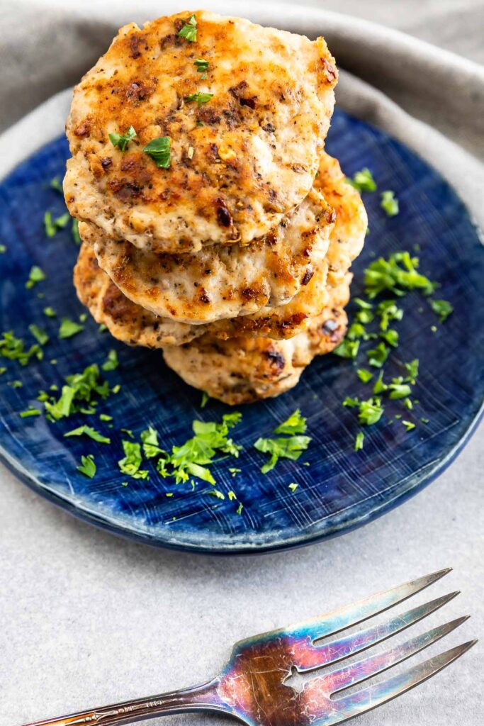 Stack of turkey breakfast sausage on a blue plate