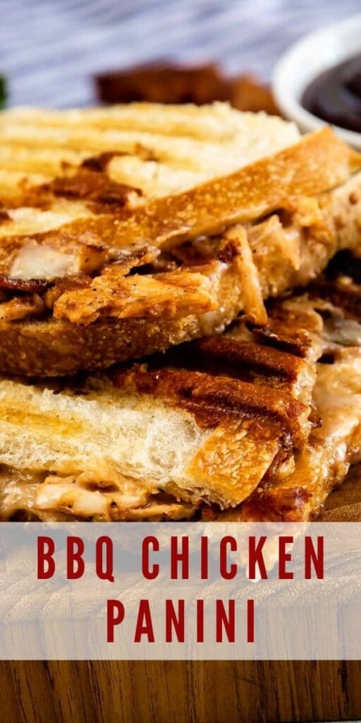 Close up of BBQ Chicken Panini on a cutting board with recipe title on bottom of photo