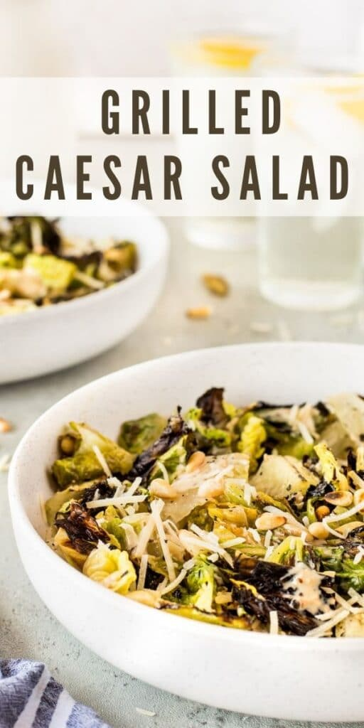 Big bowl of grilled caesar salad with recipe title on top of image