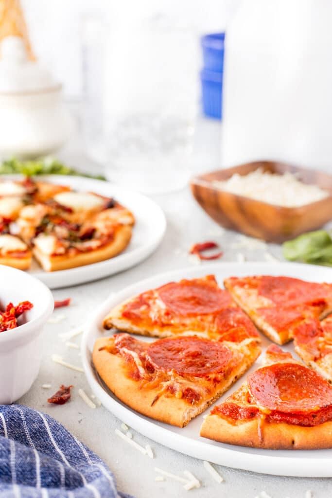 Side shot of pepperoni pita pizza